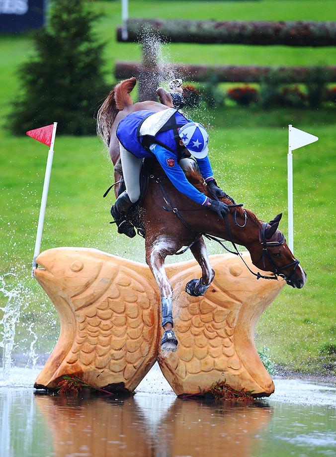 Mikhail Nastenko falls off his horse Reistag during the Longines FEI European Eventing Championship at Blair Castle, Scotland.