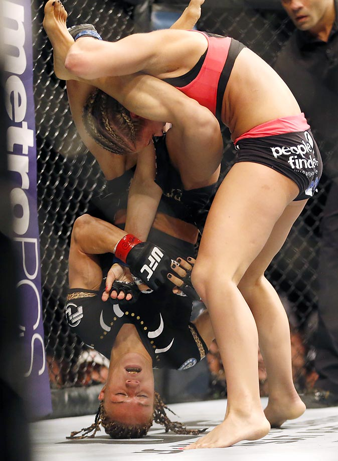 Felice Herrig gets driven into the mat by Paige VanZant during a UFC mixed martial arts bout in Newark, N.J.