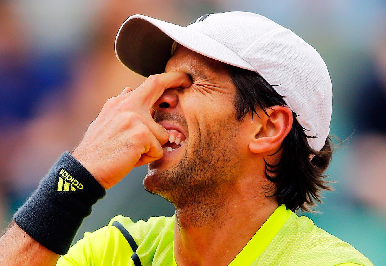 Spain's Fernando Verdasco puts his fingers in his eyes as he plays Britain's Andy Murray during their fourth-round match at the French Open.