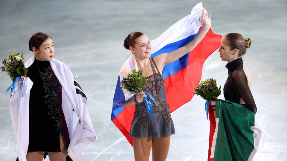 Russia's Adelina Sotnikova (c.) stunned defending champion Yuna Kim (l.) for the gold on Thursday.