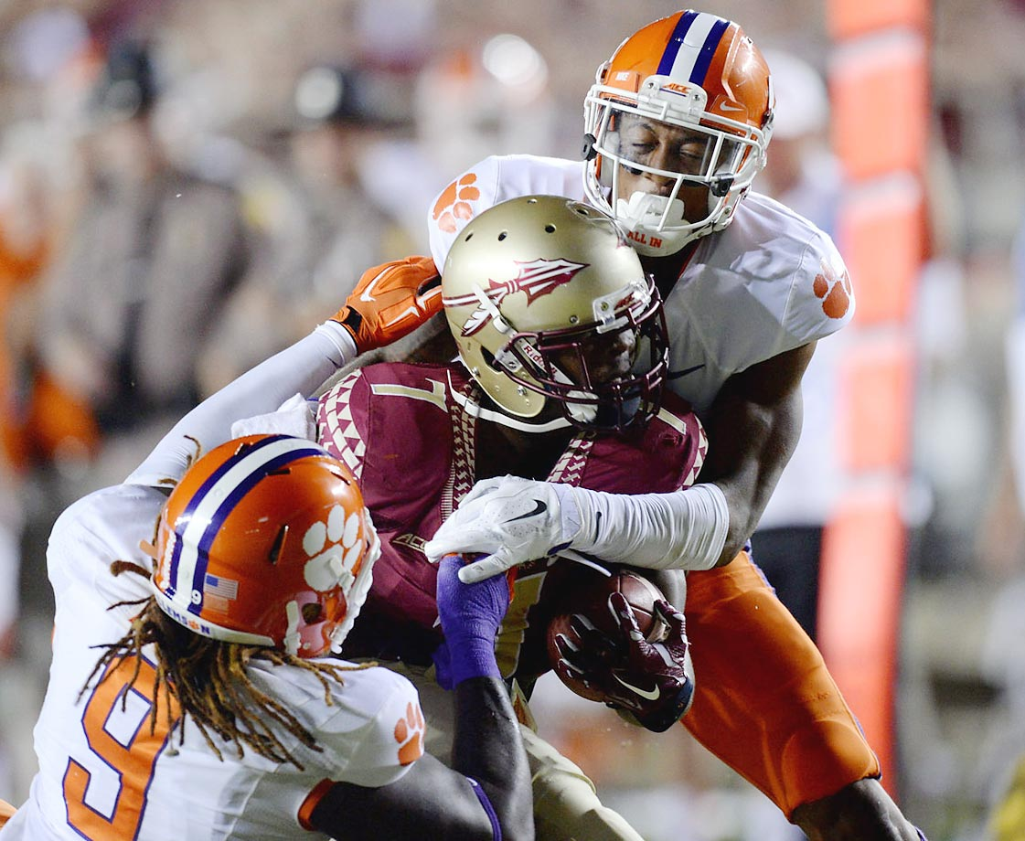 Mario Pender of Florida State is tackled by Garry Peters of Clemson.
