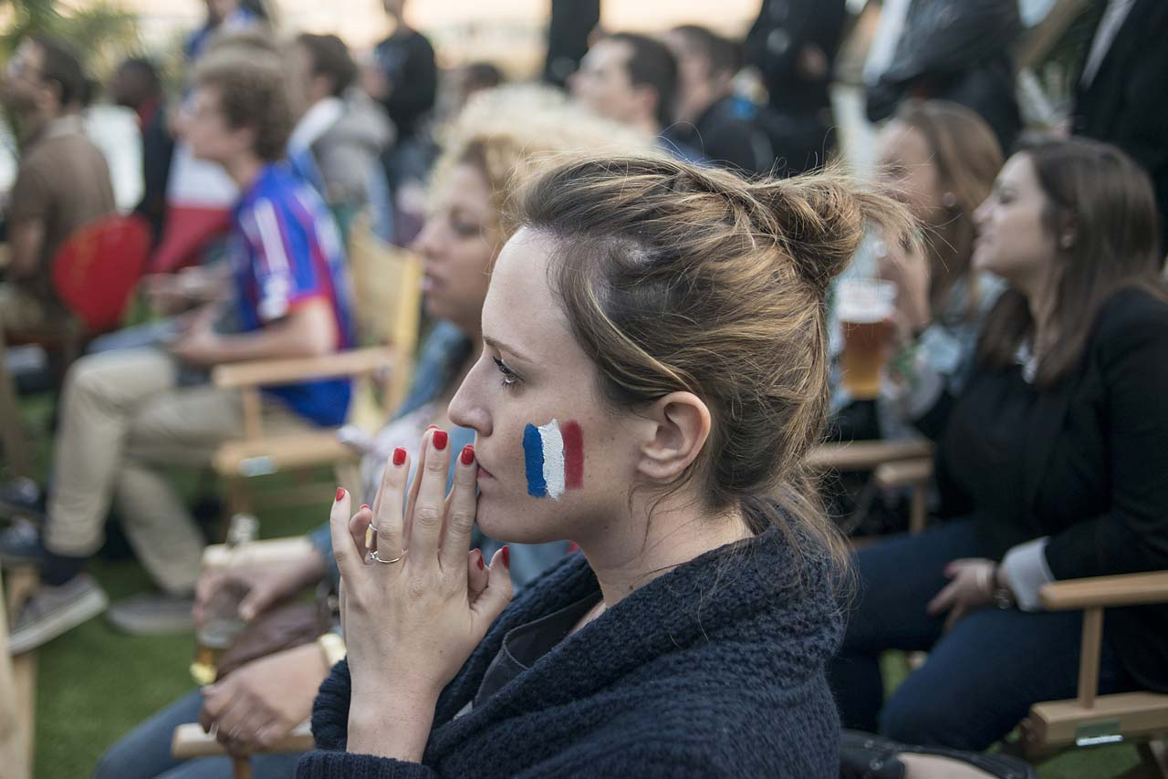 French fans gather on the barge 'Kia Cabana' in Paris to watch the match against Honduras