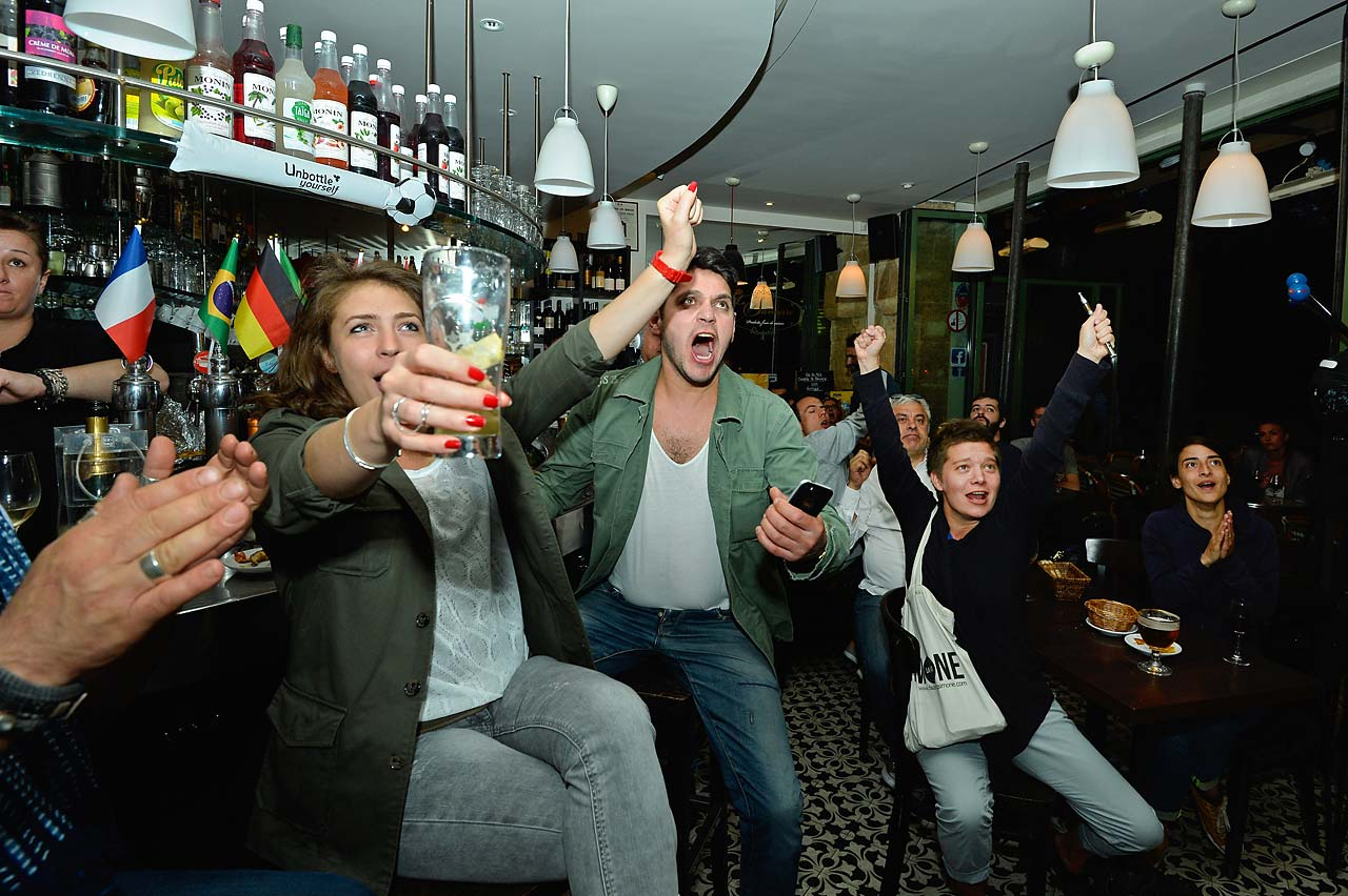 French fans celebrate the second goal of the match against Honduras, while watching the game in Paris Café, 'La Divette De Montmatre.'