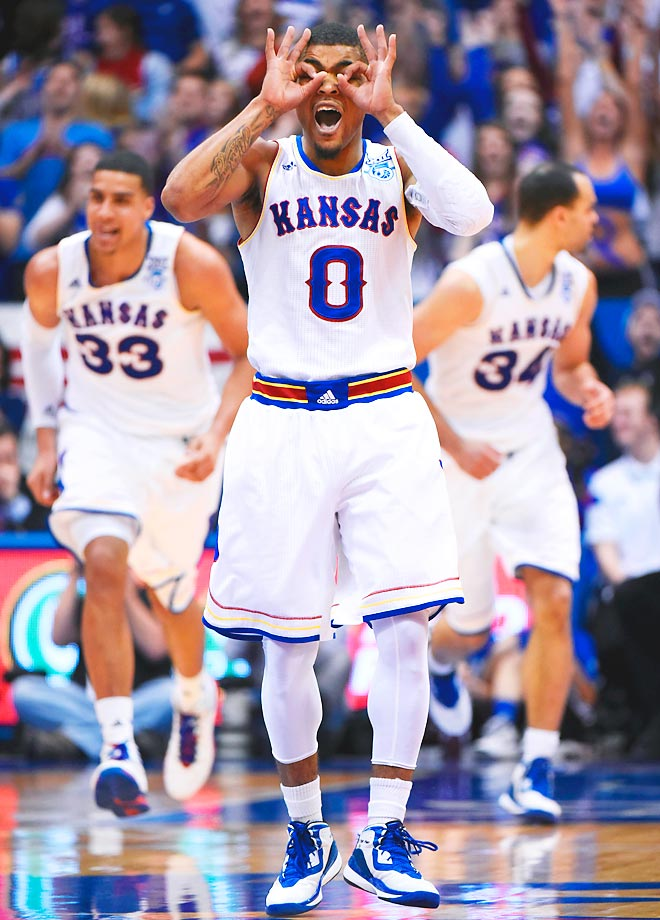 Frank Mason III celebrates a three-point shot against against the Texas Longhorns.
