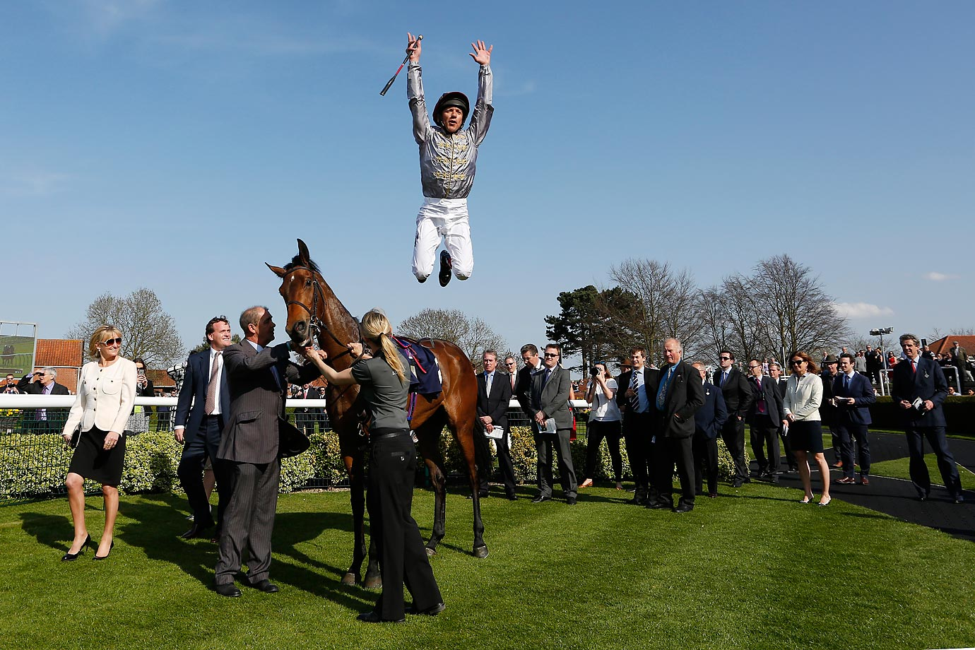Frankie Dettori leaps off his horse Osaila after winning the The Lanwades Stud Nell Gwyn Stakes at the Newmarket racecourse in England.