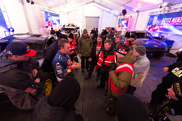 The drivers do a course discussion ahead of Red Bull Frozen Rush practice runs.