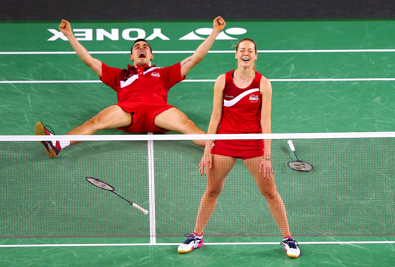 Gabrielle Adcock and Chris Adcock of England celebrate victory in the Mixed Doubles Gold Medal Match against Chris Langridge and Heather Olver of England at Emirates Arena during Day Eleven of the Glasgow 2014 Commonwealth Games on August 3, 2014 in Glasgow, United Kingdom.