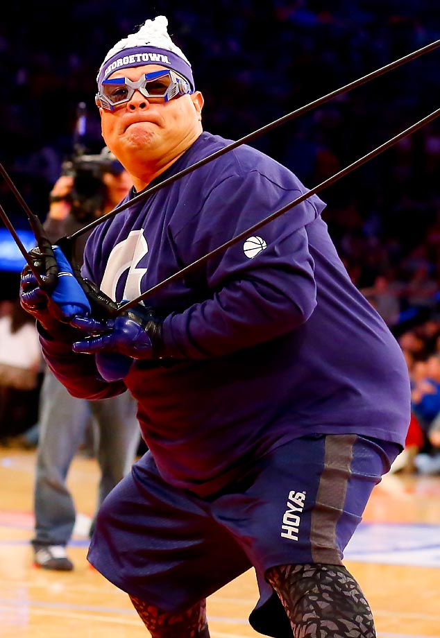 A Georgetown Hoyas fan shoots a t-shirt into the crowd during a game against Indiana.