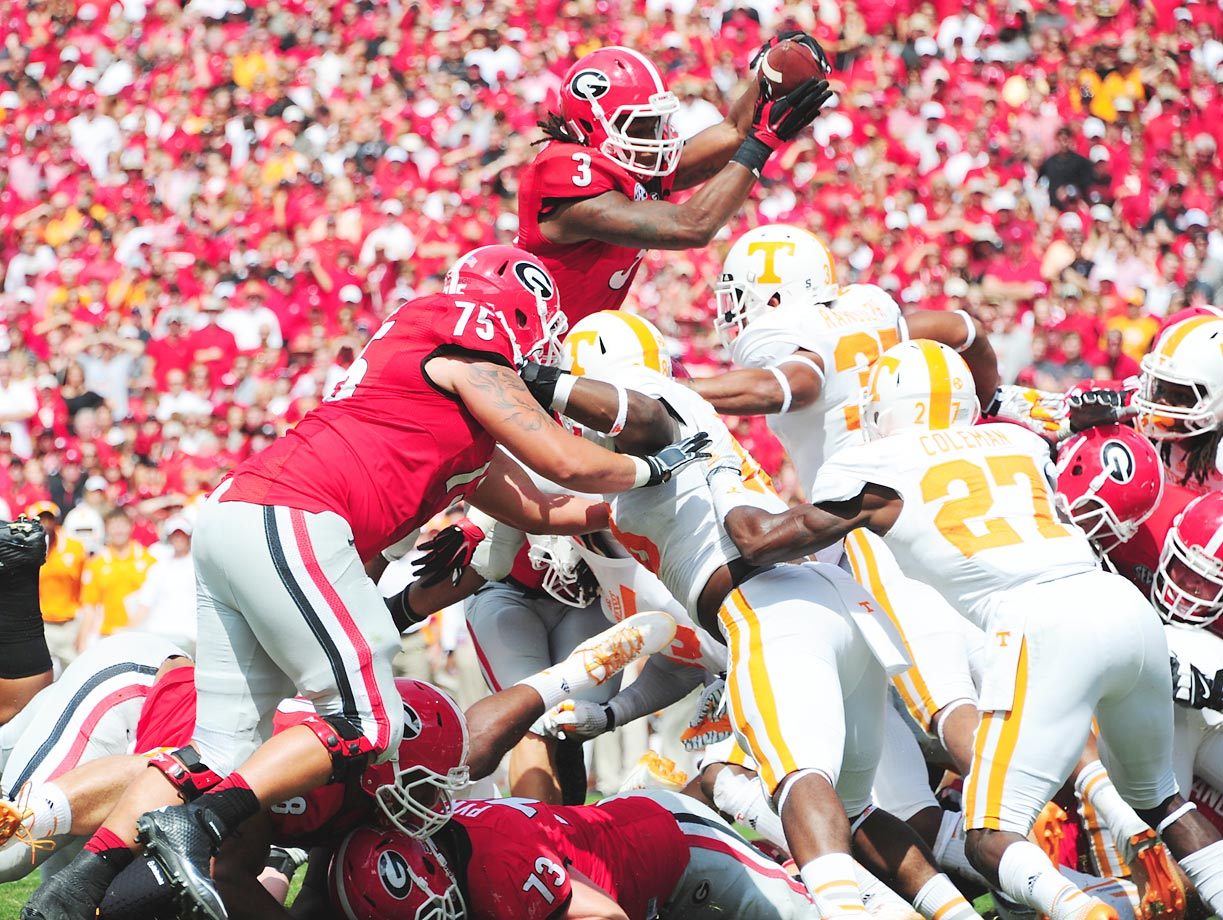 Georgia running back Todd Gurley tries to leap over defenders in the Bulldogs' 35-32 win over Tennessee.
