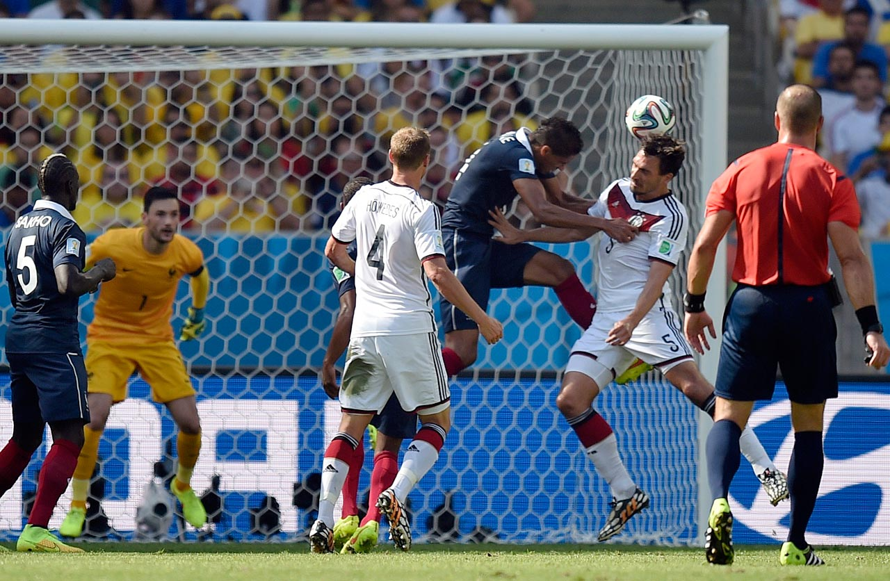 Germany center back Mats Hummels heads home the only goal in a 1-0 win over France, which secured Germany's fourth straight trip to the World Cup semifinals.