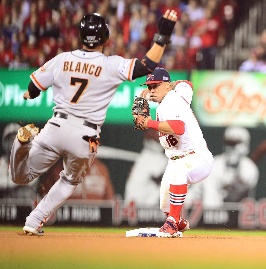 The St. Louis Cardinals' Kolten Wong turns a double play over San Francisco Giant Gregor Blanco in Game 2 of the NLCS. The Cardinals won 5-4 to tie the series at 1-1.
