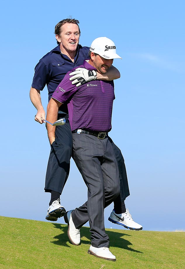 AP McCoy is given a ride by Graeme McDowell during the final practice for the 2015 Alfred Dunhill Links Championship.