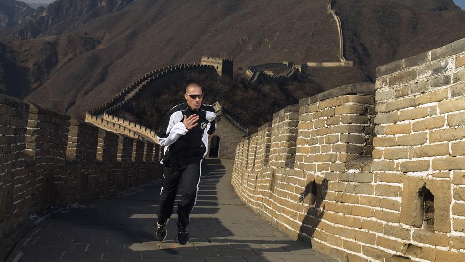 Jeremy Wariner of the USA runs up the Great Wall of China at Mutianyu