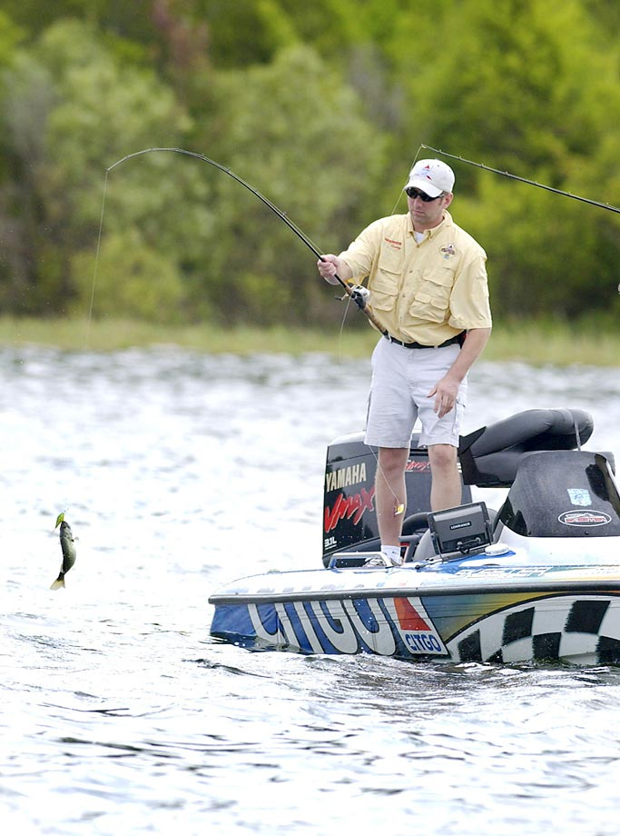 "NASCAR driver Greg Biffle reels in a largemouth bass at the Walt Disney World Resort in 2003. Biffle was among the NASCAR drivers competing in the CITGO Jeff Burton Celebrity Challenge ""Hot Rods and Reels"" fishing competition."