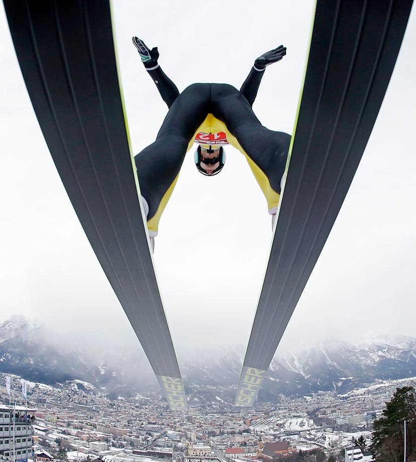 Switzerland's Gregor Deschwanden soars during the trial jump at the third stage of the four hills ski jumping tournament in Innsbruck, Austria.