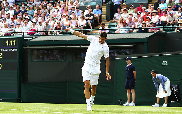 Grigor Dimitrov cruised past Ryan Harrison in straight sets.