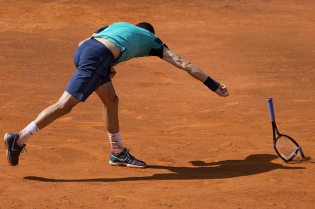 Grigor Dimitrov smashes his racket during his match against Rafael Nadal.