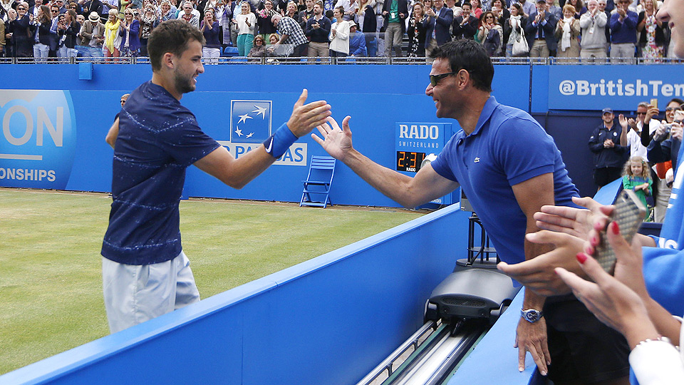 Grigor Dimitrov, guided by coach Roger Rasheed (right), is coming off the best grass-court season of his career.