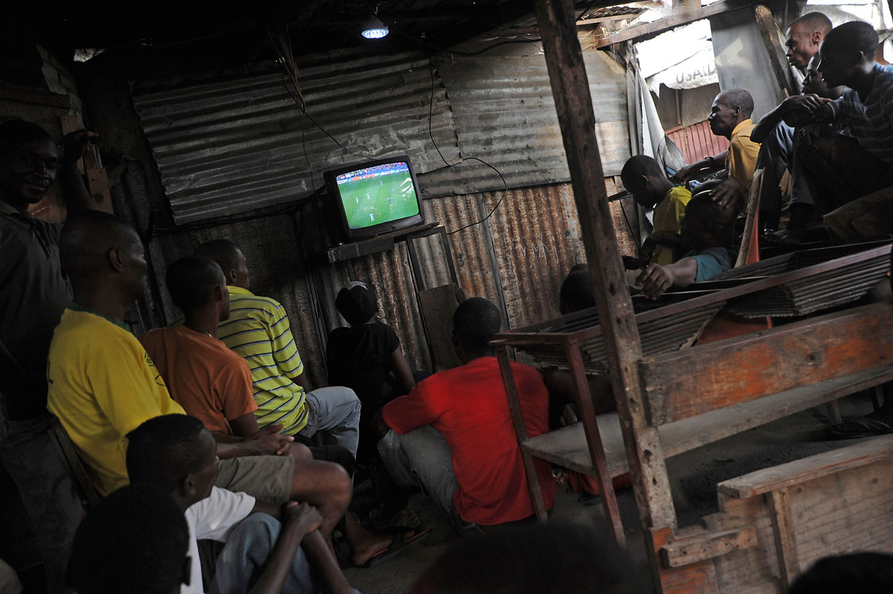 Haitians watch the match between Argentina and Bosnia-Hercegovina at Centre Kid in Christ Roi neighborhood, Port au Prince, on June 15.