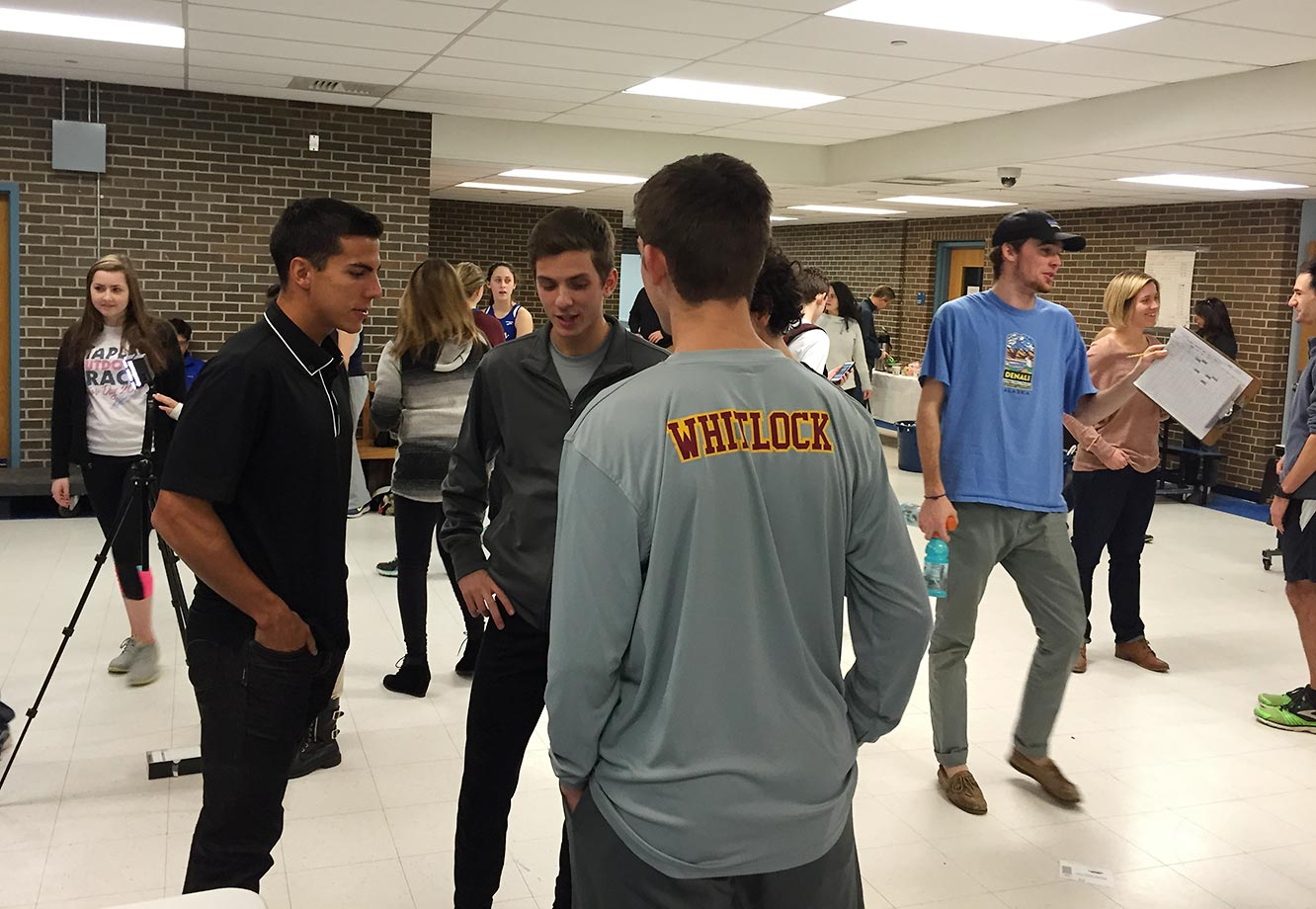 Donn Cabral, world-renowned cross country and track athlete, chats with students during the event recognizing Hannah DeBalsi as the High School Athlete selection for December.