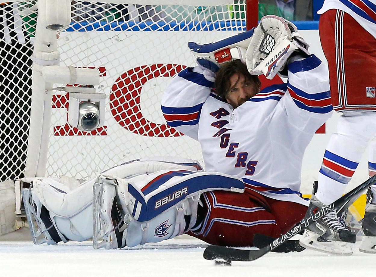 Henrik Lundqvist of the New York Rangers loses his helmet against the Tampa Bay Lightning in Game 6 of the Eastern Conference Finals.