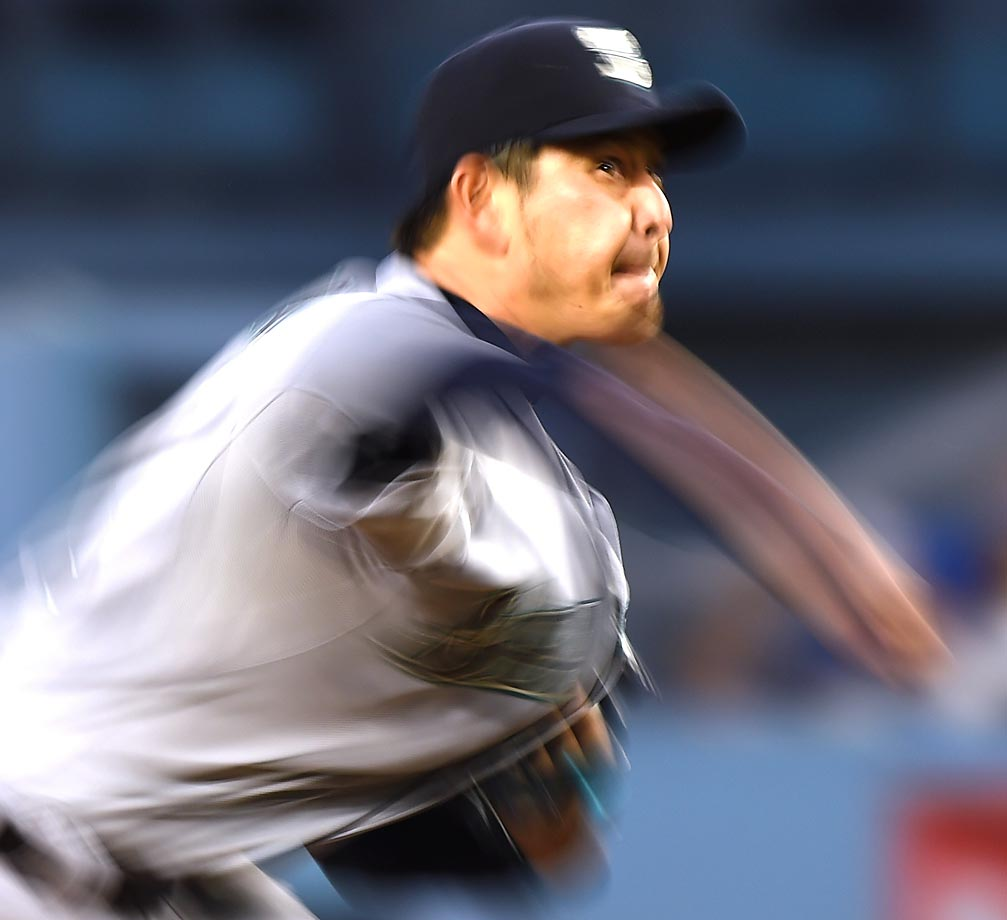 Blur action of Hisashi Iwakuma of the Seattle Mariners pitching against the Los Angeles Dodgers.