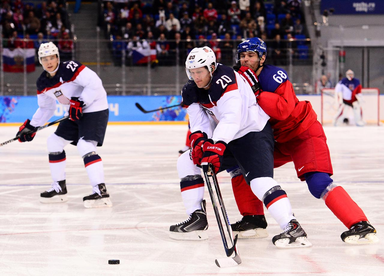 Ryan Suter of the U.S. battles against the Czech Republic.