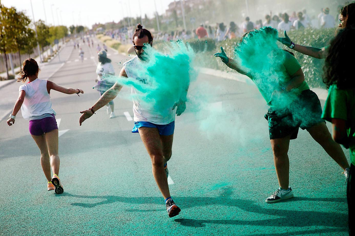 Green powder is thrown over runners at the annual Holi Run in Madrid, Spain.
