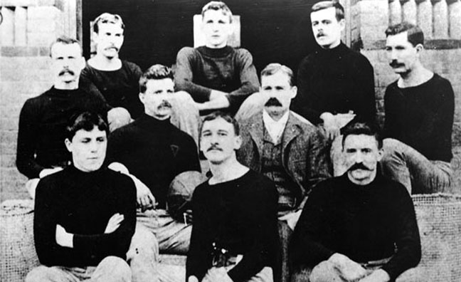 Naismith (center right) with his first basketball team in Springfield, Massachusetts.