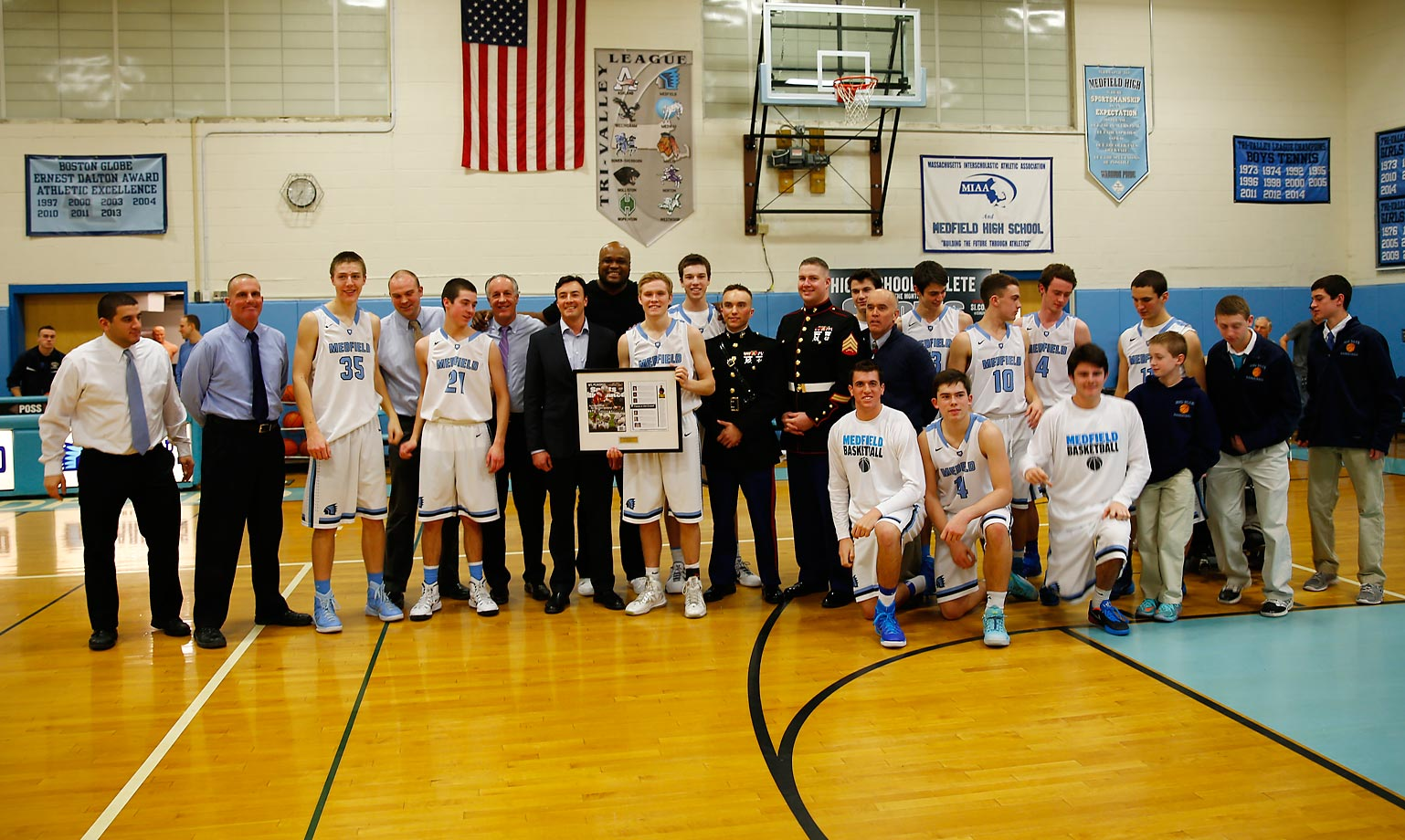 Jack's coach, Herb Grace, along with the rest of the varsity squad, joined him in the ceremony.