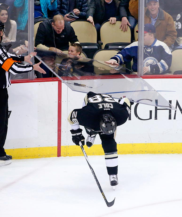 A sheet of glass falls onto Ian Cole of the Pittsburgh Penguins after he was checked by Ryan Johansen of the Columbus Blue Jackets.  There were no reported injuries.