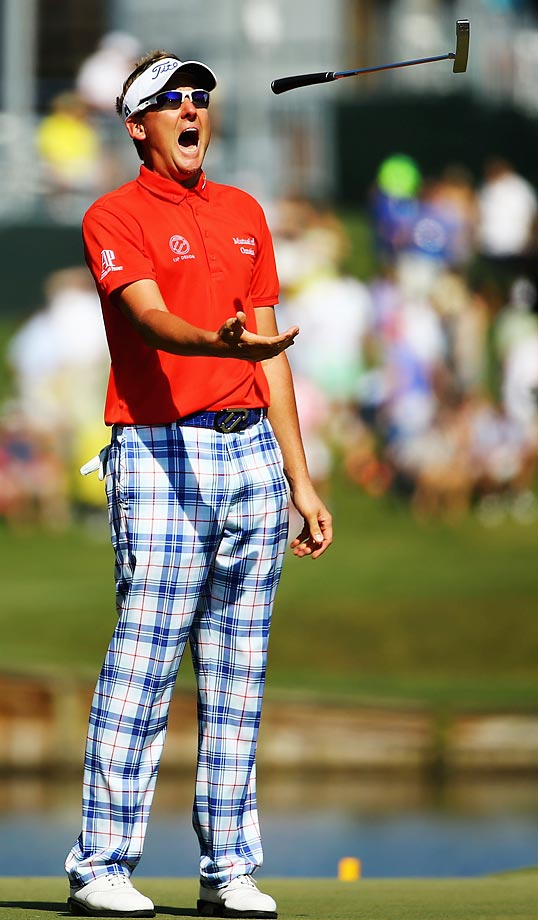 Ian Poulter reacts after missing a putt during the third round of the Players Championship.