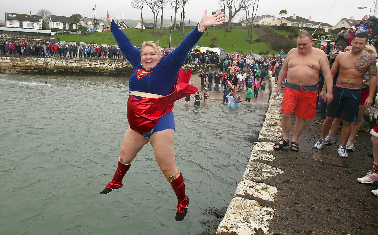 A woman takes a plunge into Carnlough harbor in Northern Ireland on New Year's Day during a charity event.