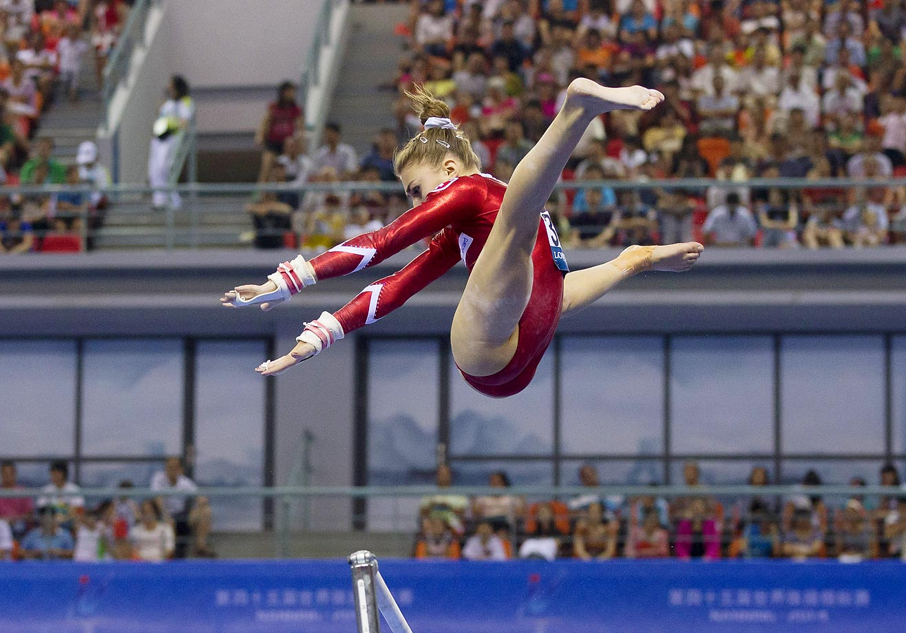 Switzerland's Ilaria Kaeslin leaps from the uneven bars as she competes in the qualifying round of the Artistic Gymnastics World Championships in China.