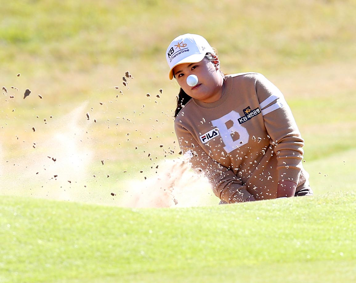 South Korea's Inbee Park plays her shot from the bunker at the 18th green during the final day of the Women's British Open at the Royal Birkdale Golf Club, in Southport, England, on July 13, 2014.