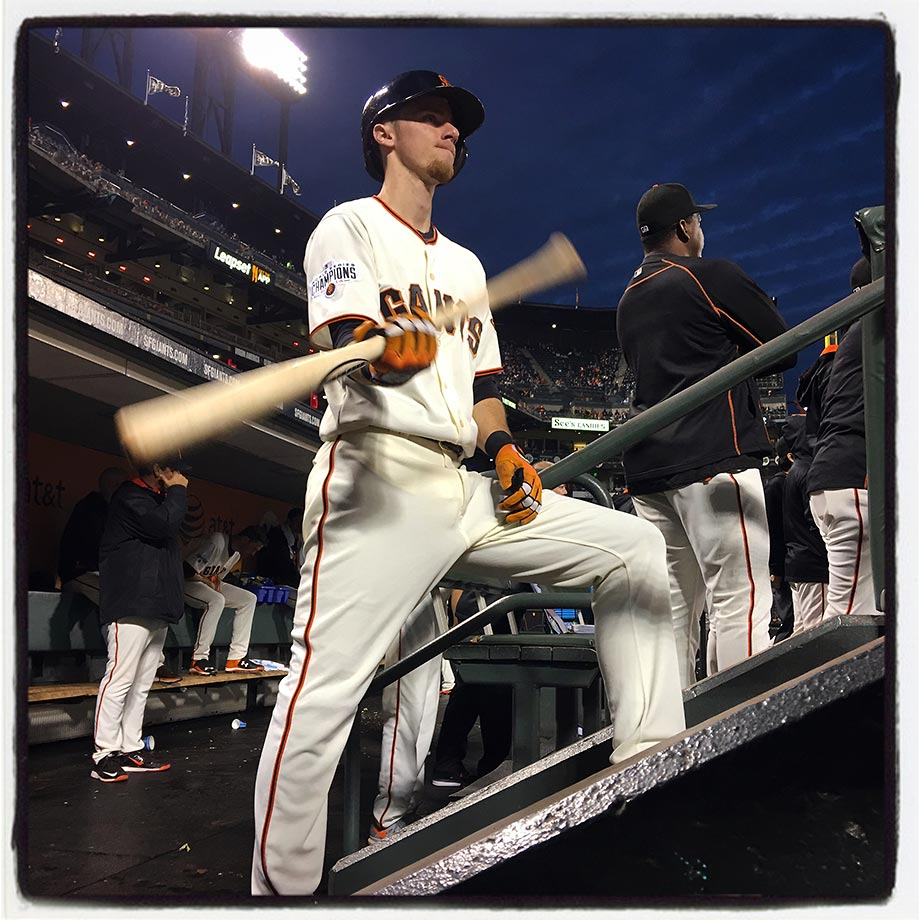 Rookie of the year candidate and San Francisco Giants third baseman Matt Duffy getting ready in the dugout for his first at bat of the game against the Cincinnati Reds in the bottom of the first inning on Tuesday night, September 15, 2015 at AT&T Park in San Francisco.