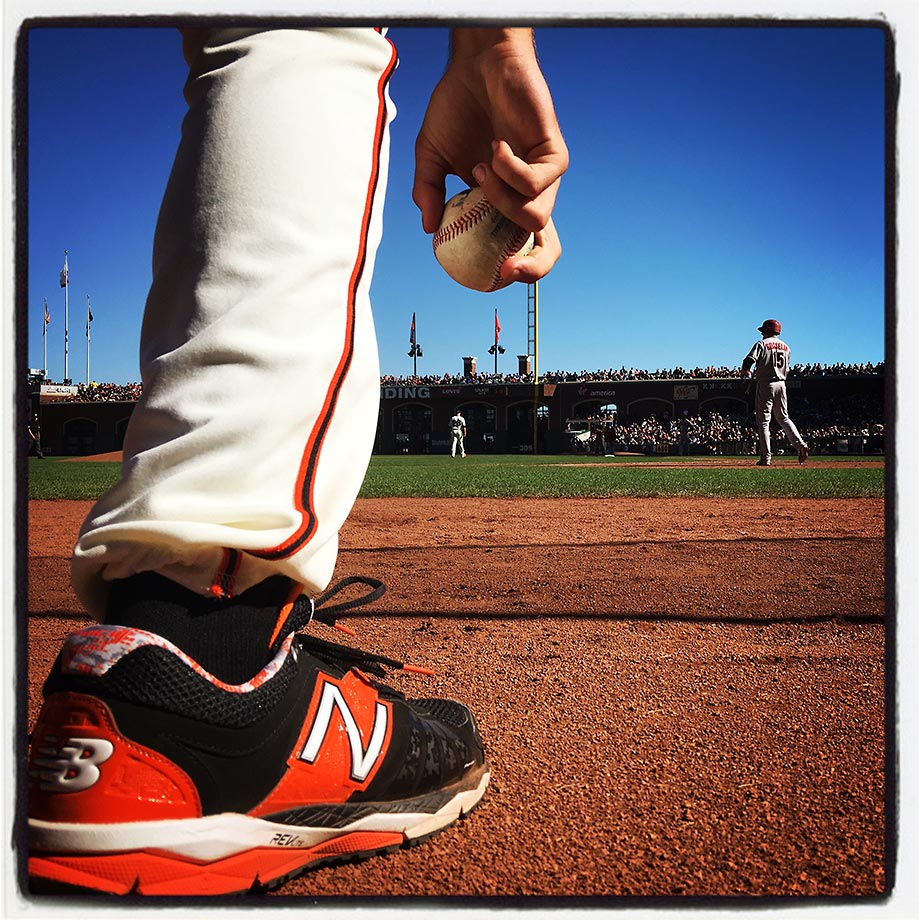 A San Francisco Giants bat boy picks up a baseball on the field during the game against the Arizona Diamondbacks at AT&T Park in San Francisco on Saturday, Sept. 19, 2015.