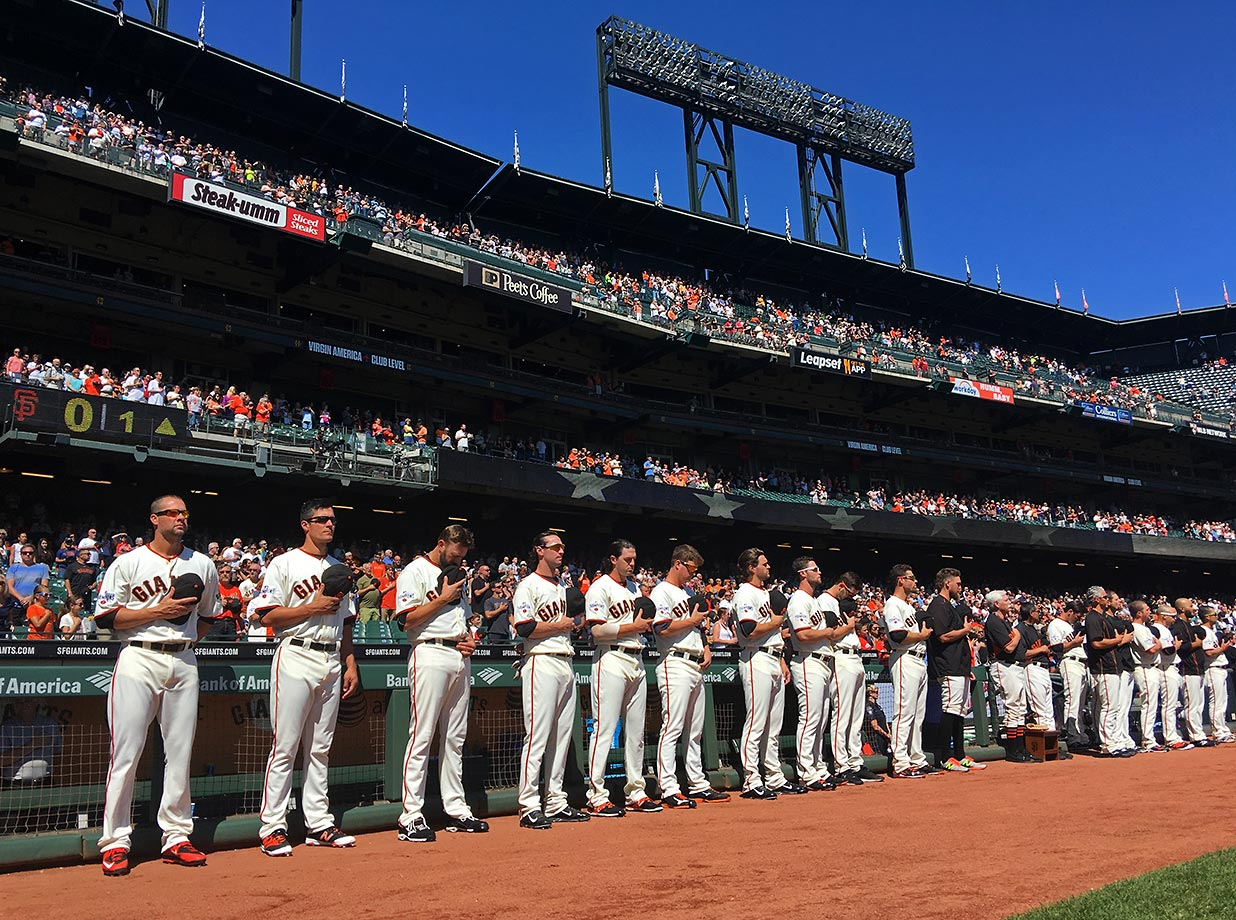The San Francisco Giants stand on the field for the National Anthem before a game against the Arizona Diamondbacks at AT&T Park in San Francisco on Sunday, Sept. 20, 2015.