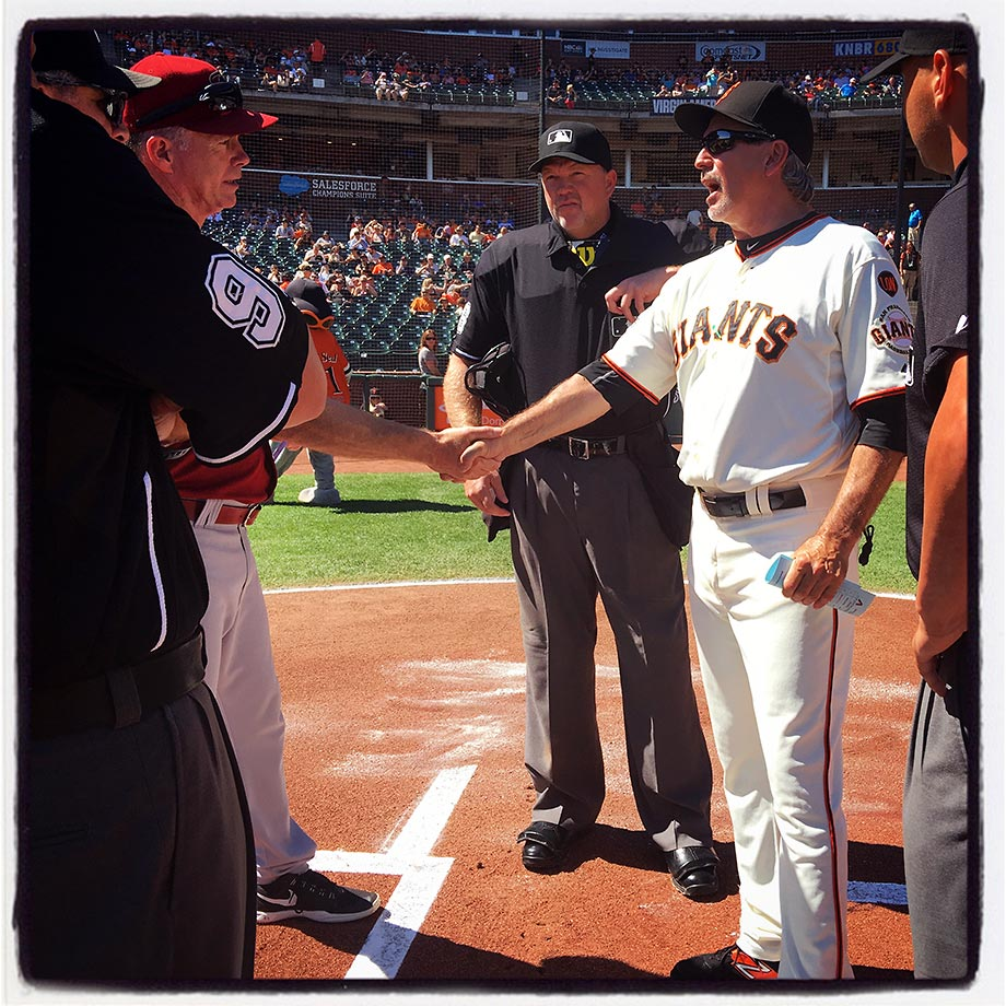 Home plate umpire Ron Kulpa organizes the meeting at home plate before the game between the Arizona Diamondbacks and San Francisco Giants at AT&T Park in San Francisco on Sunday, Sept. 20, 2015.