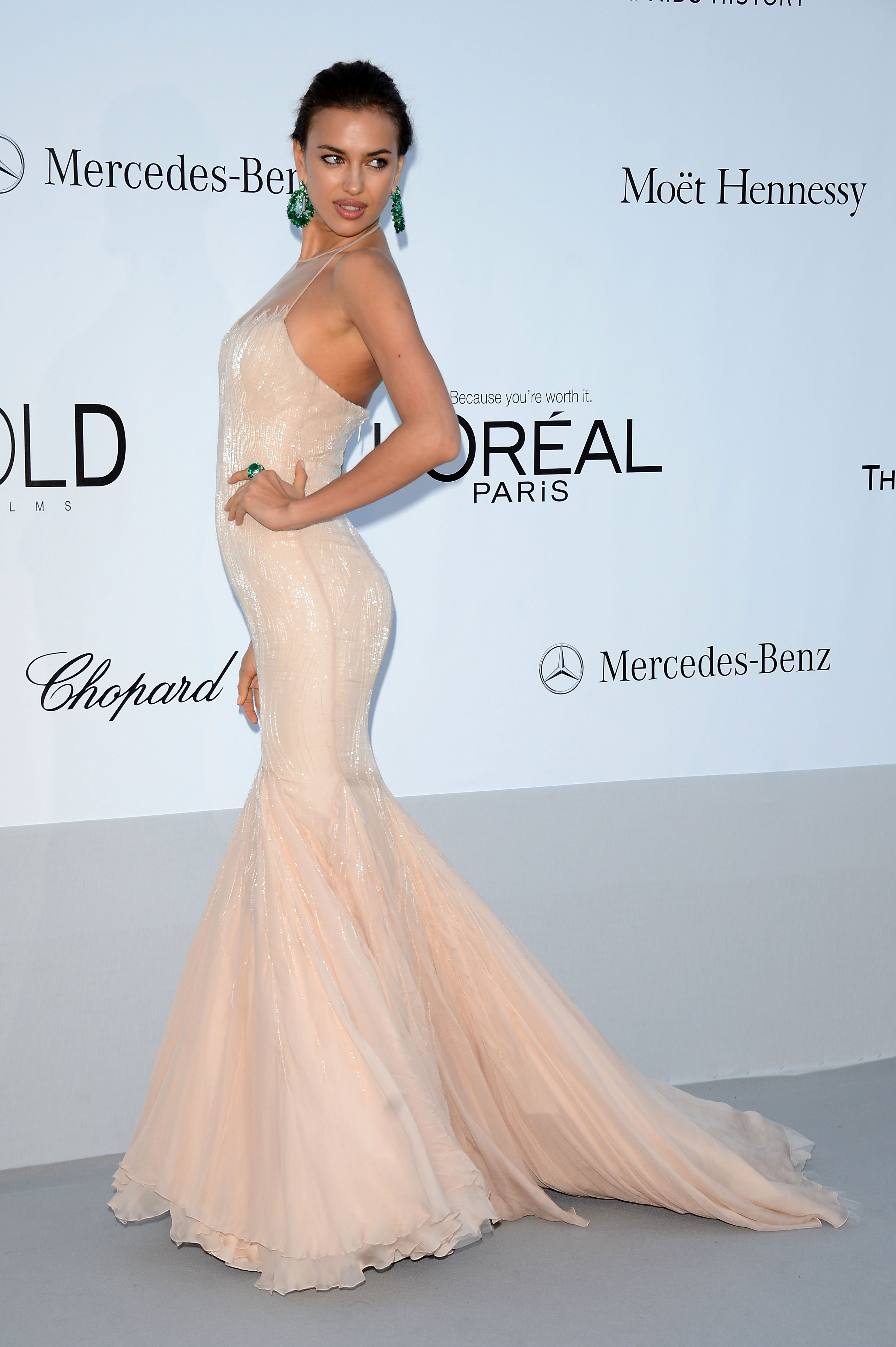 Irina Shayk arrives at 2012 amfAR's Cinema Against AIDS during the 65th Annual Cannes Film Festival.