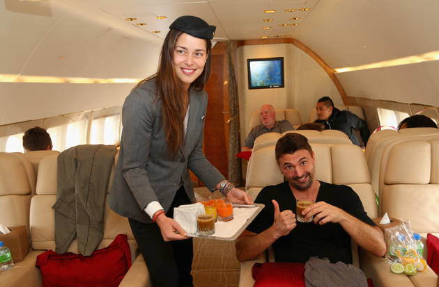 Ivanovic serves drinks to Goran Ivanisevic on a private jet from Manila to Singapore.