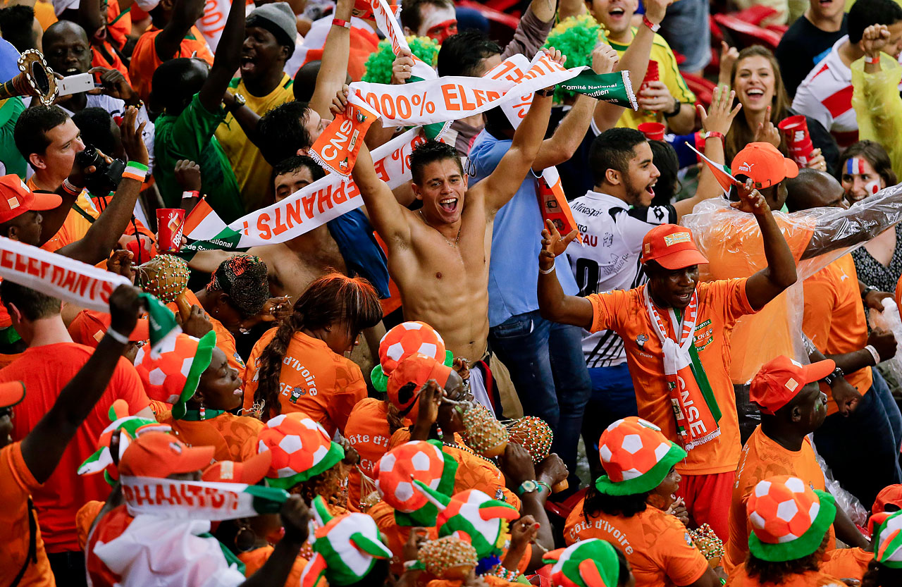 Ivory Coast fans cheer prior to their team's game against Japan.