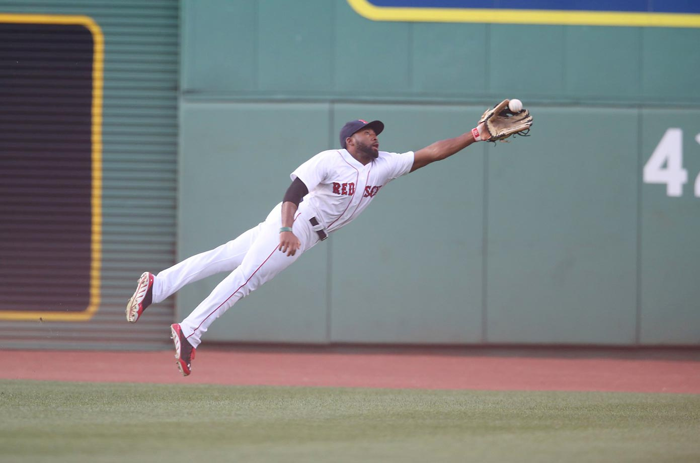 Boston Red Sox outfielder Jackie Bradley Jr. stretches to make a phenomenal diving catch against the Chicago White Sox on July 9, 2014 at Fenway Park in Boston.