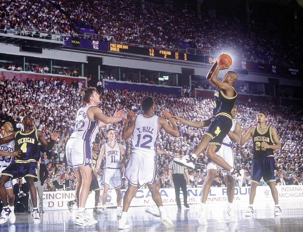 Jalen Rose of Michigan shoots a jumper over Antonio Lang of Duke in the final. Duke defeated Michigan 71-51.