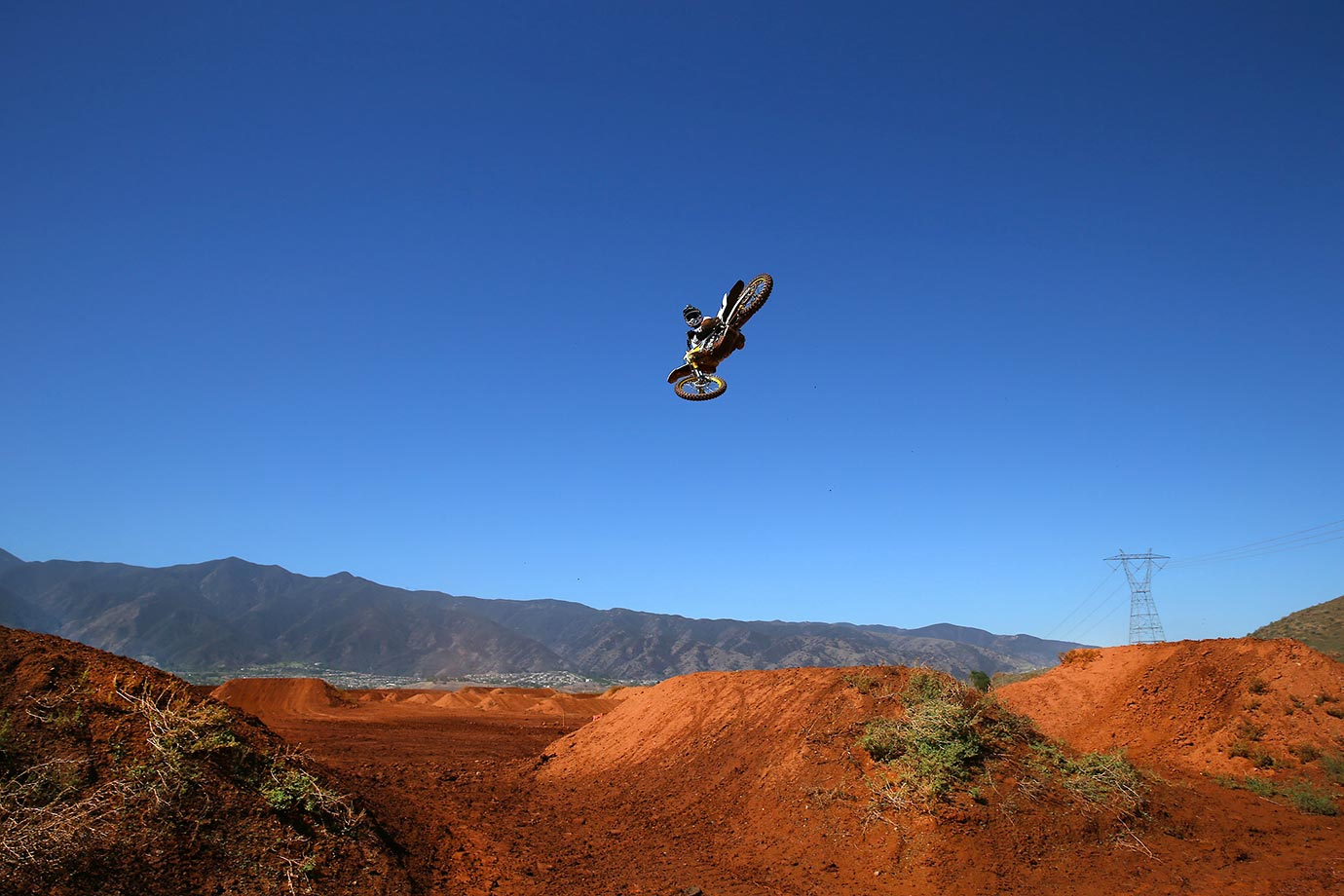 James Stewart whips across the blue southern California sky during his training for the upcoming Monster Energy Cup.