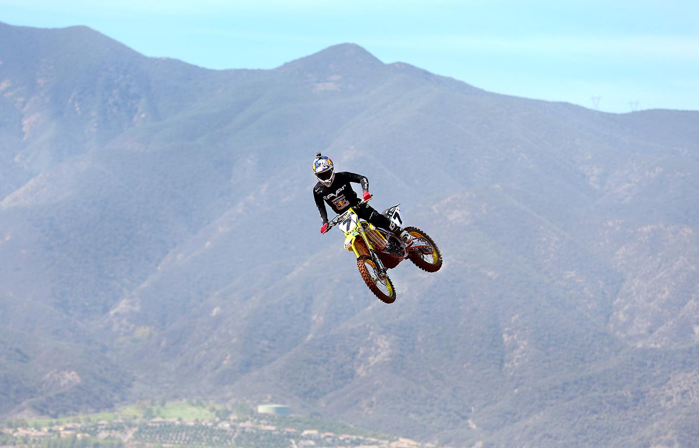 Stewart in mid air and dwarfed by the mountains of southern California as a backdrop.