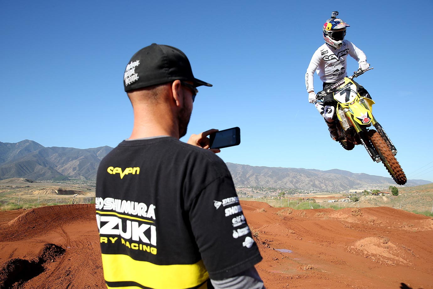Stewart is timed and filmed by members of his Suzuki team during practice.