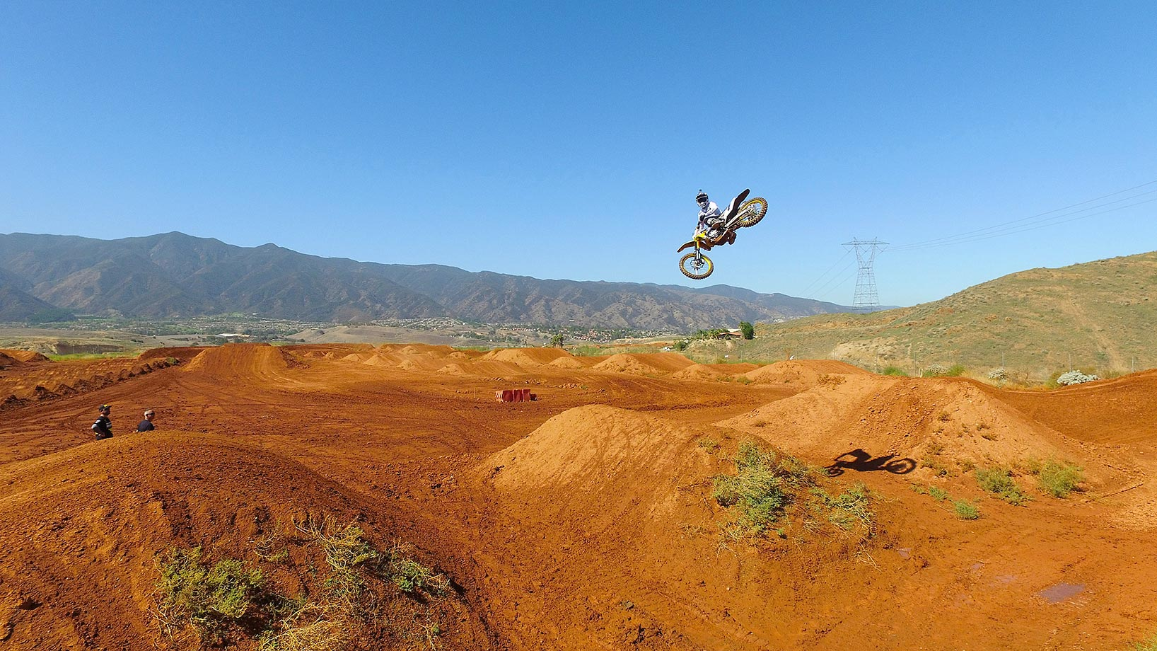 Stewart whips his bike in mid-air over a jump during practice.