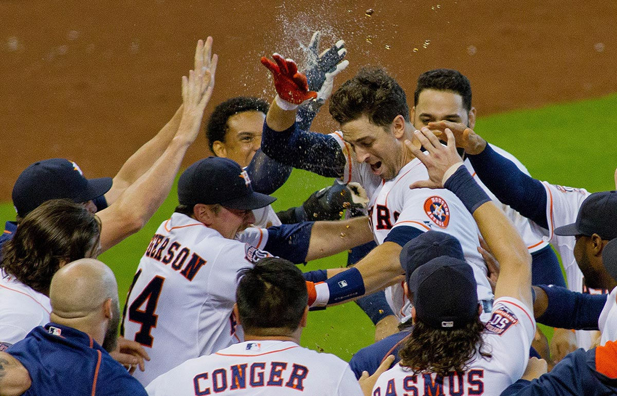 Jason Castro is greeted by teammates after his walk-off home run against the Los Angeles Dodgers in the tenth inning gave the Astros a 3-2 victory on Aug. 23.