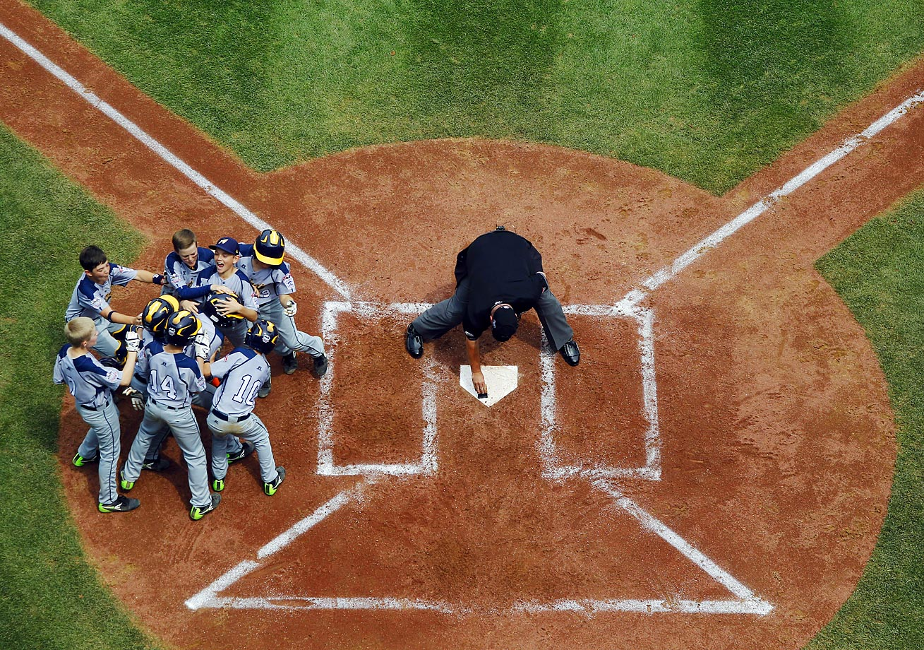 Australiaís Javier Pelkonen is mobbed by teammates after hitting a home run during the fourth inning of a baseball game against the Czech Republic at the Little League World Series. Australia won 10-1.